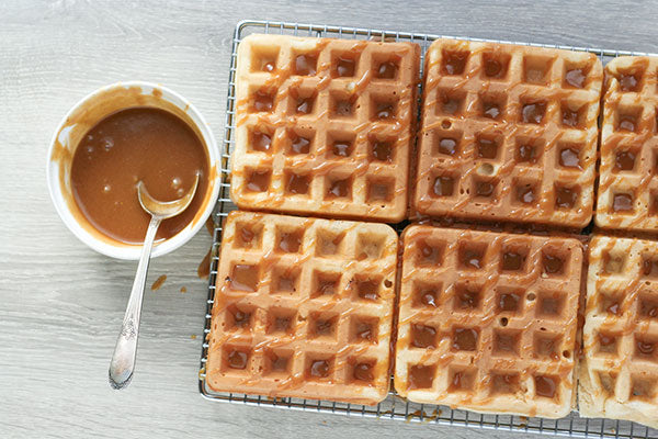 Yeasted Peanut Butter Waffles with Peanut Butter Syrup - Serve the waffles while warm and drizzle them generously with the syrup.