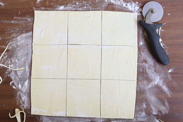 Peanut Butter and Jelly Turnovers - Trim with a knife as necessary to get clean, straight edges. Cut the square into 9 3-inch squares.
