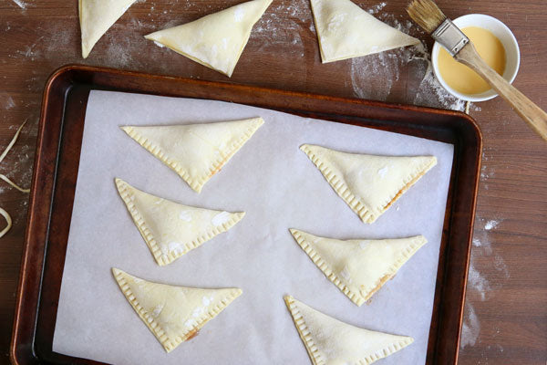 Peanut Butter and Jelly Turnovers - Place the turnovers on a sheet pan lined with parchment paper and freeze for 30 minutes.