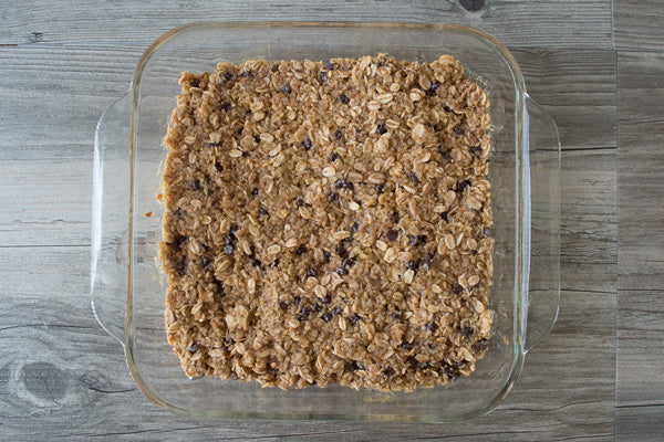 Peanut Butter Quinoa Bars - Transfer the peanut butter quinoa mixture to the baking pan and distribute evenly