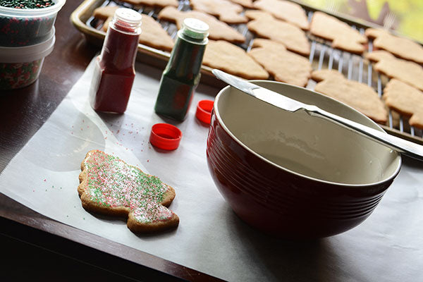 Glazed Christmas Tree Peanut Butter Cookies - Spread a thin layer of glaze on a cooled cookie and immediately sprinkle on colored sugar or sprinkles
