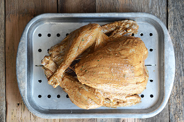 Rub the peanut butter mixture all over the outside of the turkey.