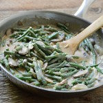 Thai-Inspired Creamy Peanut Butter Green Bean Casserole - 6. Stir the coconut milk mixture, green beans, and fresh basil into the skillet with the mushroom/onion mixture