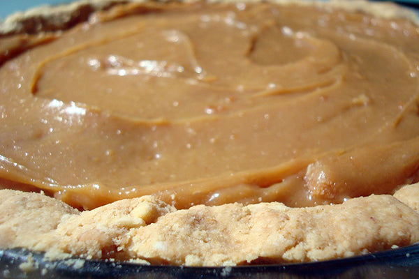 Salted Caramel Peanut Butter Pie - Once the mixture has cooled, gently spread it into the finished pie shell