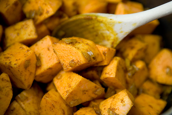 Peanut Buttery Sweet Potato, Spinach & Mushroom Stew - Add the curry paste to the onion mixture and cook, stirring for 1 minute. Add the sweet potatoes, stir to coat with the onion mixture, and fry for 3-4 minutes.