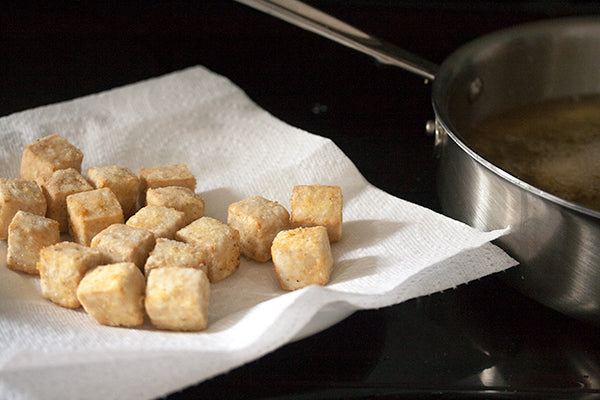 Crispy Tofu Bites with Sweet & Spicy Peanut Sauce - Serve the tofu while it's still piping hot and crispy, with a small bowl of dipping sauce on the side.