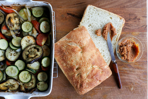 Roasted Vegetable Sandwich with Garlic Peanut Butter Spread - Slice the ciabatta loaf in half horizontally and spread the peanut sauce across the top and the bottom halve