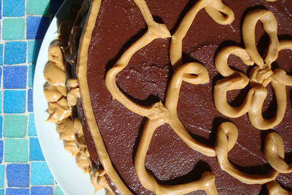 """Cut off the tip of the corner of the bag, and use it to """"draw"""" whatever designs you'd like on the cake. I did some freehand work."""