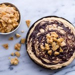 When ready to serve remove the pie from the freezer and top with 1 cup of coconut peanut brittle.