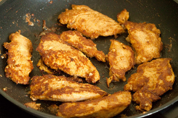 Fry the chicken for about 3–5 minutes and then flip and cook for another 2–4 minutes.