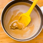 In a medium saucepan over low heat, melt the coconut oil, peanut butter chips, Mighty Maple, and maple syrup together until smooth. Remove from heat.