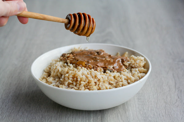 Cinnamon Raisin Peanut Butter Rice Pudding - Place the two cups of rice in a microwave safe bowl. Top with the Cinnamon Raison Swirl peanut butter, and drizzle with the honey. Microwave for 1-3 minutes (depending on your microwave) until the peanut butter starts to melt and becomes easy to stir.