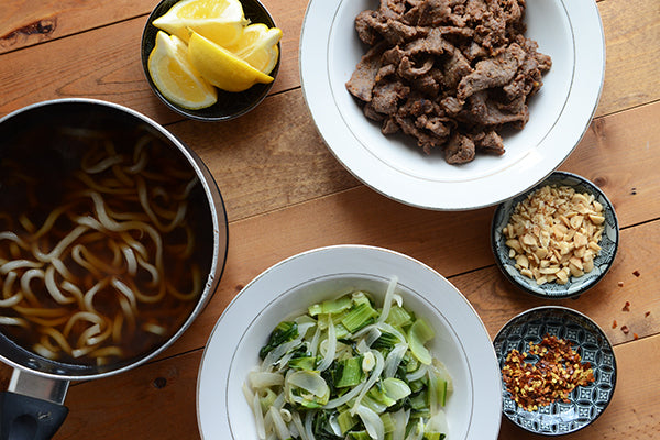 Beef with Udon Noodles and Baby Bok Choy with Peanut Butter Sauce assemble noodle bowl