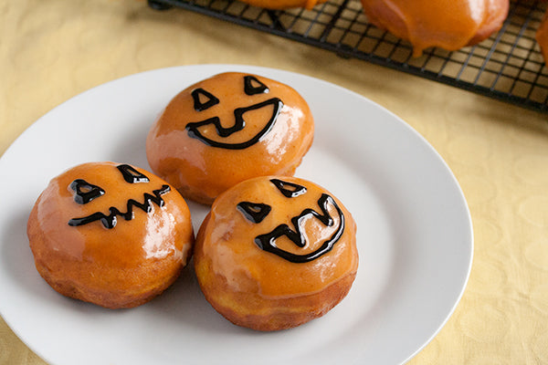 Pumpkin Doughnuts with Peanut Butter Cream