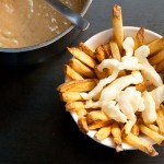 Top each one with ¼ cup of cheese curds, then pour a generous amount of satay sauce over top. Garnish with a sprinkling of cilantro, then serve immediately.