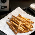 Sprinkle the fries generously with salt as they come out of the fryer.