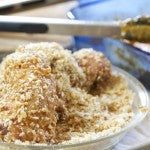 4. Dip each tenderloin in the egg mixture followed by the bread crumb mixture, coating generously.