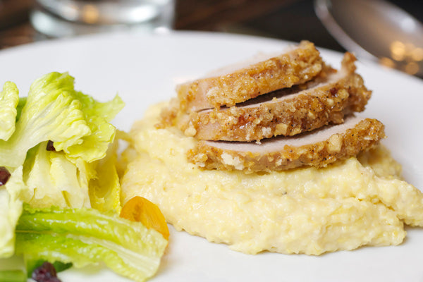 Pork loin is such a versatile meat and can be transformed in so many ways. The crushed peanuts and bread crumbs in this recipe provide a nice crispy exterior. Typically, polenta is finished off with butter but I've used smooth peanut butter here to add additional flavor and to match the flavor of the pork.