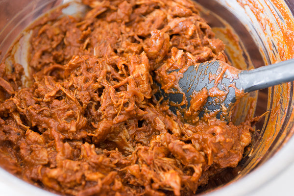 Add the shredded chicken to the remaining sauce and stir to combine. Taste for seasonings and adjust as needed.