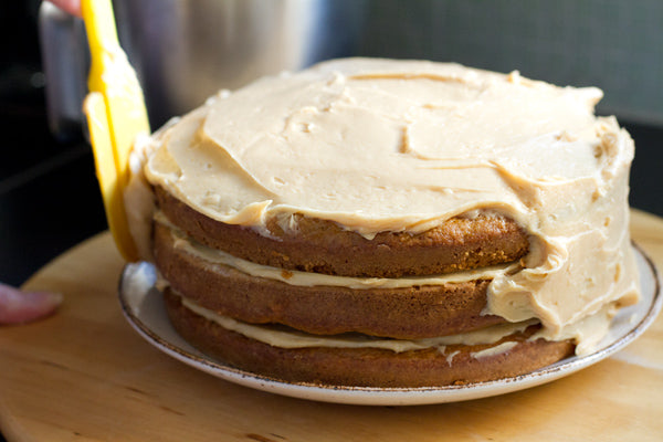 Spread frosting over sides and top of cake