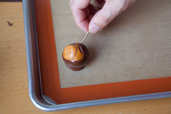 Sassy Peanut Butter Marbled Buckeyes - place them on the lined baking sheet