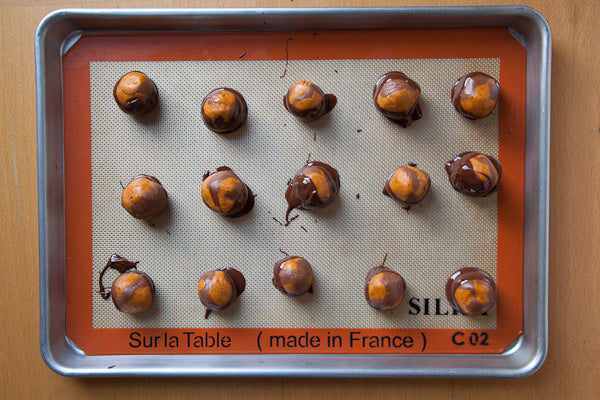 Sassy Peanut Butter Marbled Buckeyes - place in the refrigerator to solidify the chocolate