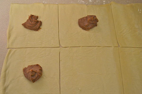 Peanut Butter Pinwheels with Peanut Butter Drizzle - Dollop 1 tablespoon filling into the center of each square of rolled dough