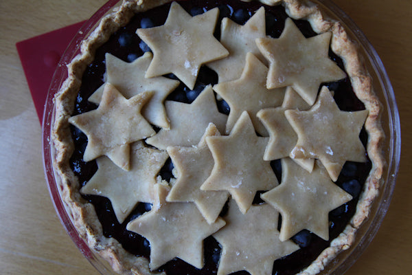 Concord Grape Pie with White Chocolate Peanut Butter Crust - Place the cut out dough on top of the filling