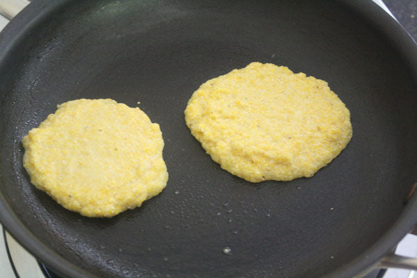 Sweet Peanut Butter Breakfast Arepas - Scoop 1/4 cup servings of dough onto the pan and cook on each side until firm