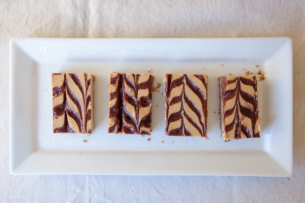 Peanut Butter and Jelly Cheesecake Bars - To cut and serve, grab the parchment paper by its sides and lift the entire cheesecake out of the pan and move it directly to a cutting board to cut
