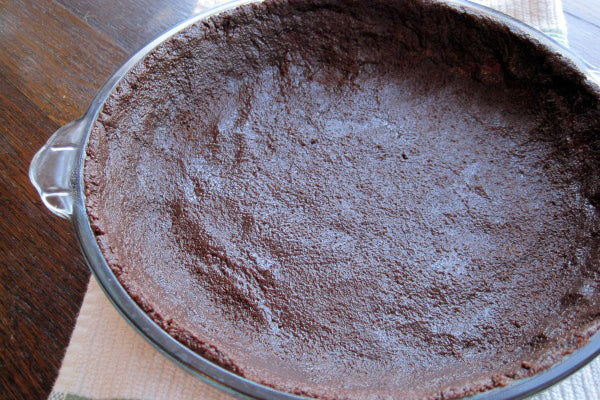 "Peanut Butter ""Ice Cream"" Pie with Chocolate Cookie Crumb Crust - press the crust evenly into the bottom and up the sides"