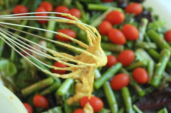 Spring Asparagus Salad with White Chocolate Peanut Butter Mustard Dressing - Toss the vegetables with 2/3 of the dressing