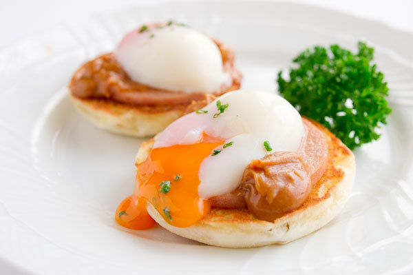 Peanut Butter Eggs Benedict - Gently place an egg on top of each muffin