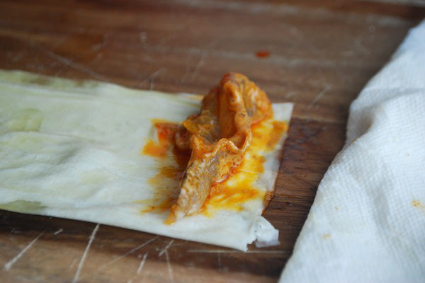 Spicy Filo Wrapped Peanut Butter Orange Shrimp - Lay one of the prepared and marinated shrimp along the short end of the folded filo