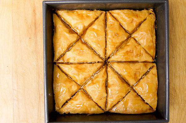 White Chocolate Peanut Butter Baklava - as soon as the baklava comes out of the oven, drizzle the honey on top