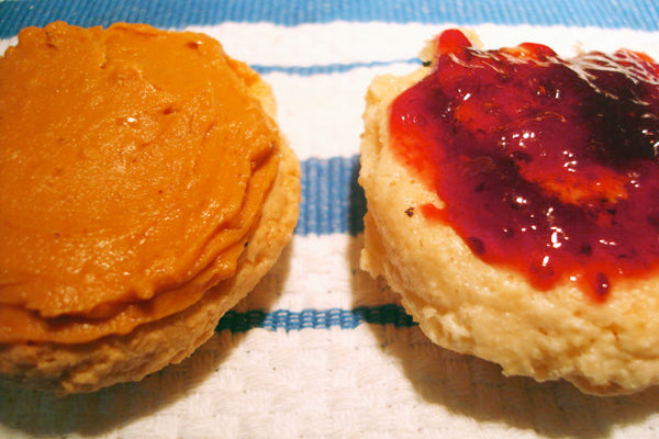 PB&J Macarons - On one of the cookie half, spread a thin layer of preserves; on the other half, spread White Chocolate Wonderful peanut butter