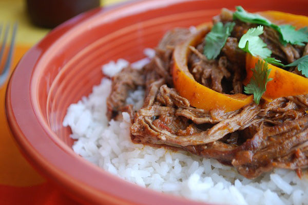 Dark Chocolate Peanut Butter Ropa Vieja (Shredded Beef Stew) - Remove the bay leaves and serve over white rice, arranging the bell pepper slices on top