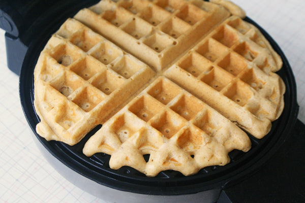 The Bee's Knees Peanut Butter Waffles - keep the waffles warm in a baking dish in a 250°F oven while you finish cooking the batter