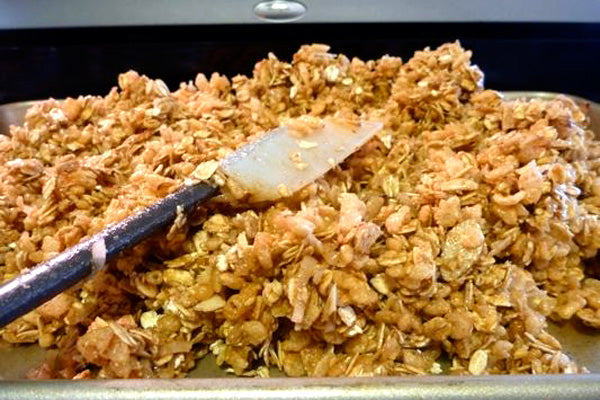 Maple Peanut Butter Granola - Add the oats, coconut, almonds, and rice cereal and gently toss until all ingredients are coated