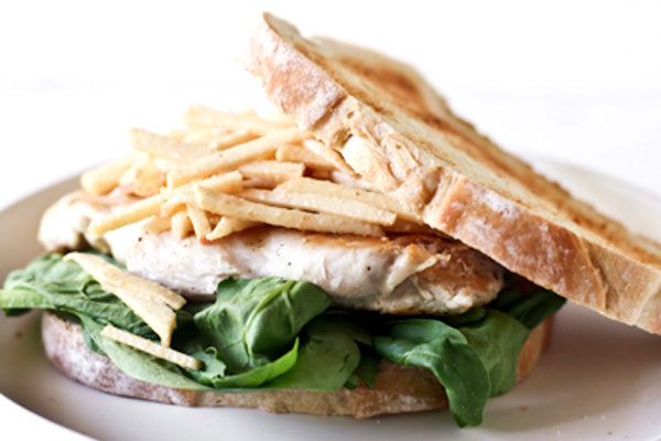 The Bee's Knees Special - To assemble your sandwich, start with a slice of sourdough, coat with peanut butter dressing. Top with spinach, chicken breast, slaw, and bread