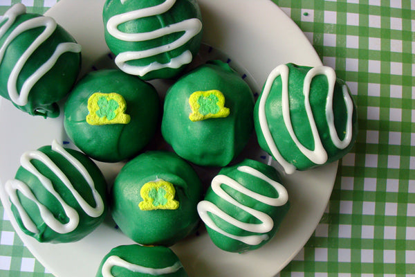 St. Patrick's Day Peanut Butter Truffles - If you're garnishing with sprinkles, apply the sprinkles while the candy coating is still slightly warm to ensure that they stick