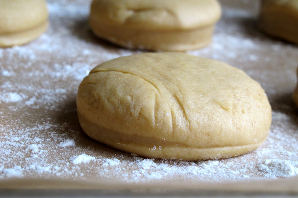 Peanut Butter and Jelly Doughnuts - Transfer dough rounds to a parchment-lined baking sheet