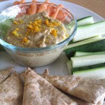 Hummus served with pita and vegetables