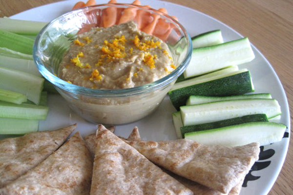 Orange-Peanut Butter Hummus - Scrape hummus into a serving bowl and sprinkle with remaining orange zest for garnish