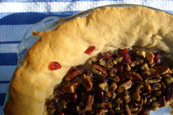 Cranberry Pecan Pie in a Maple Peanut Butter Crust - Bake at 325°F for 35-40 minutes, or until filling is set