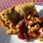 slice of finished cranberry pecan maple pie