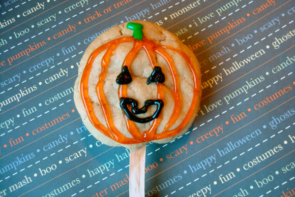 Halloween Peanut Butter Cookie Pops - Decorate with orange, green and black gel or writing icing to make them resemble pumpkins