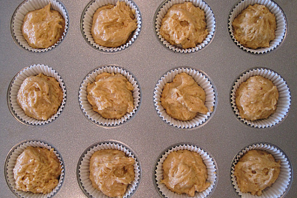 Mini Peanut Butter Cupcakes with Pumpkin Cream Cheese Frosting - Whisk together the gluten-free baking & pancake mix, baking powder, and kosher salt.  Add the flour and milk to the batter in three parts, starting and ending with the flour.