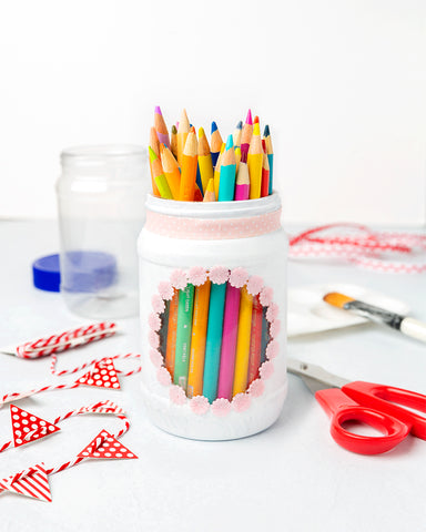Empty Peanut Butter Jar Repurposed Into a Pencil Holder Filled with Colored Pencils