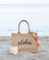 Small Aloha Reusable Shopping Tote In Black Font On The Beach With Coconut And Lei | The Little Market